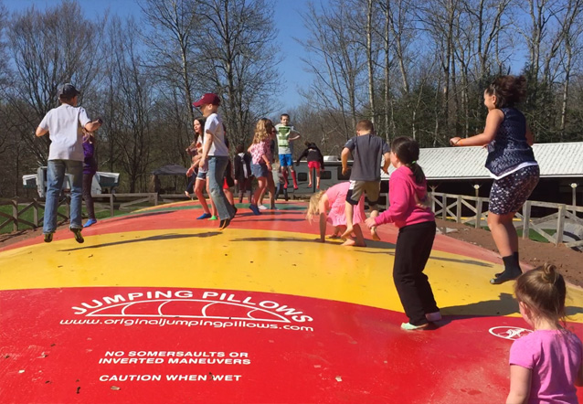 Photo of kids on jumping pillow