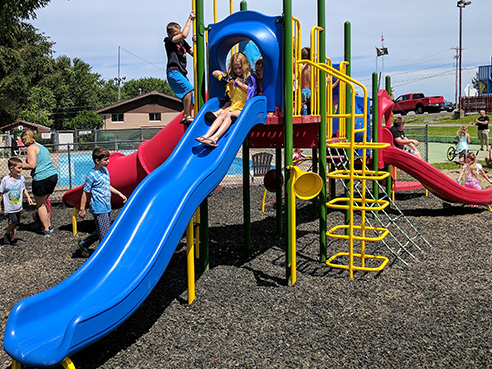 photo of playground with young children