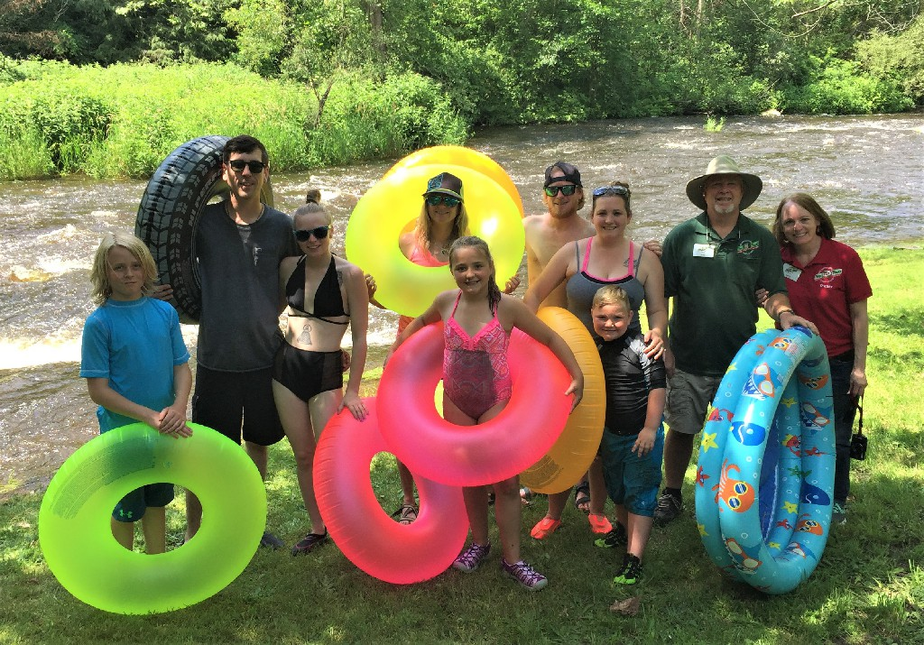 Campers with their floaties by the river