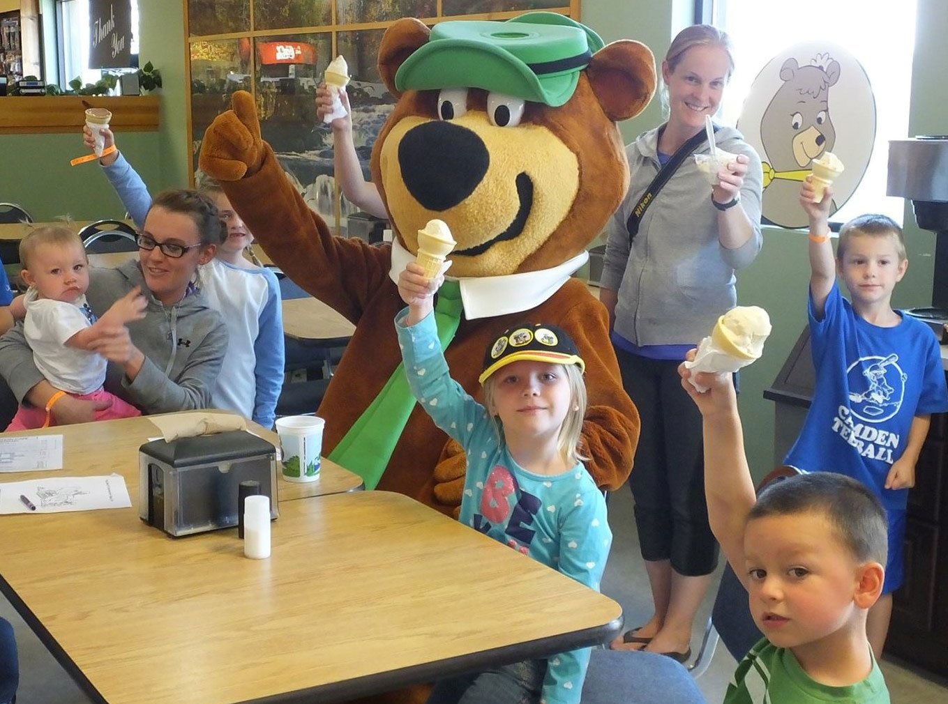 Yogi Bear and young campers having ice cream
