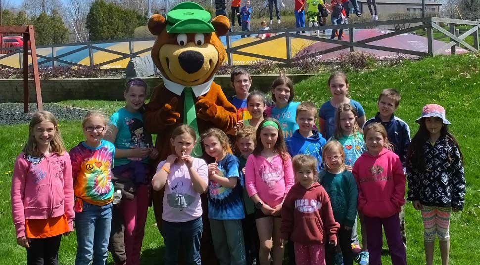group of children with Yogi Bear